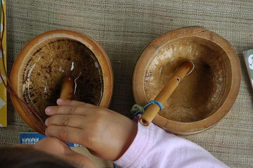 Blow the bamboo whistle into a shallow dish of water, and it sounds like a baby bird!