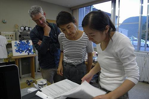 Keiko and David discuss with Keiko Kudo about what to cook at Saturday's international cooking party.
